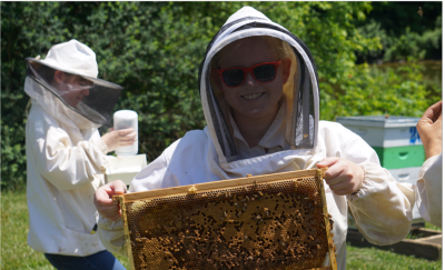 Student holding bee frame